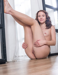 Erna poses on the floor as she flaunts her meaty pussy.
