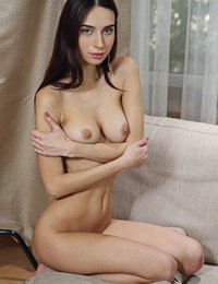 Dita V flaunts her slim body with beautiful tits as she strips on the couch.