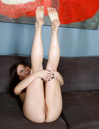 Newcomer Nicki Raye flaunts her plump ass and smooth pussy on the couch.