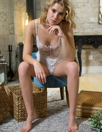Casey strips her lingerie baring her nice tits and sweet pussy on the floor.