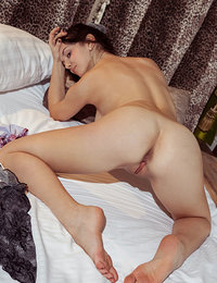 Anatali strips on the bed as she flaunts her sweet pussy.