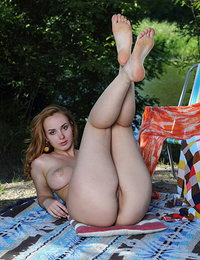 Vos shows off her gorgeous tits and delectable pussy outdoors.