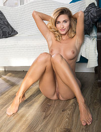 Gorgeous Cara Mell smile sweetly for the camera as she poses naked in the sofa