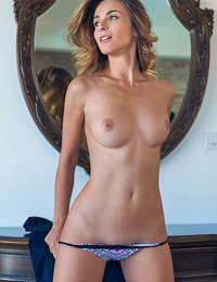 Alluring Cara Mell strips in front of the camera baring her smoking hot body.