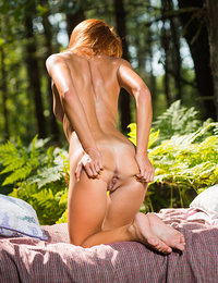 Michelle H spends a sensual afternoon posing naked in the woods