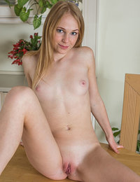 Runa shows off her nubile body and sweet pussy on the table.