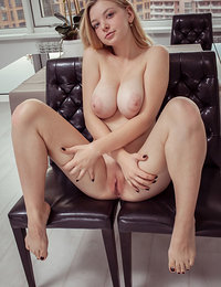 Busty Daniel Sea shows off her gorgeous tits and smooth pussy.
