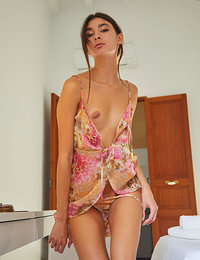 Bambi Joli shows off her petite body with small tits on the chair.
