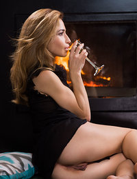 Susie strips by the fireplace as she bares her nubile body.