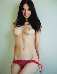 Dita V shows off her beautiful tits and sweet pussy on the couch.