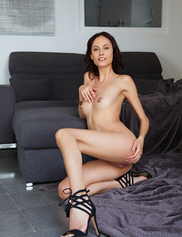 Sade Mare strips on the floor as she displays her perky tits and slender body.